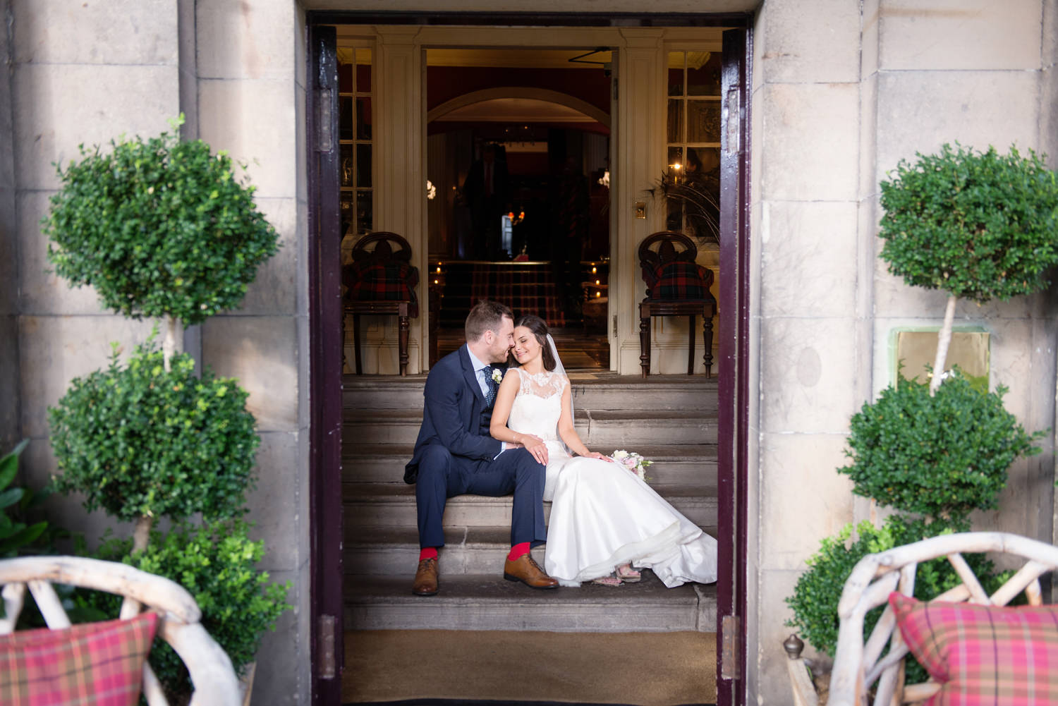 Newlyweds kissing at Prestonfield_House