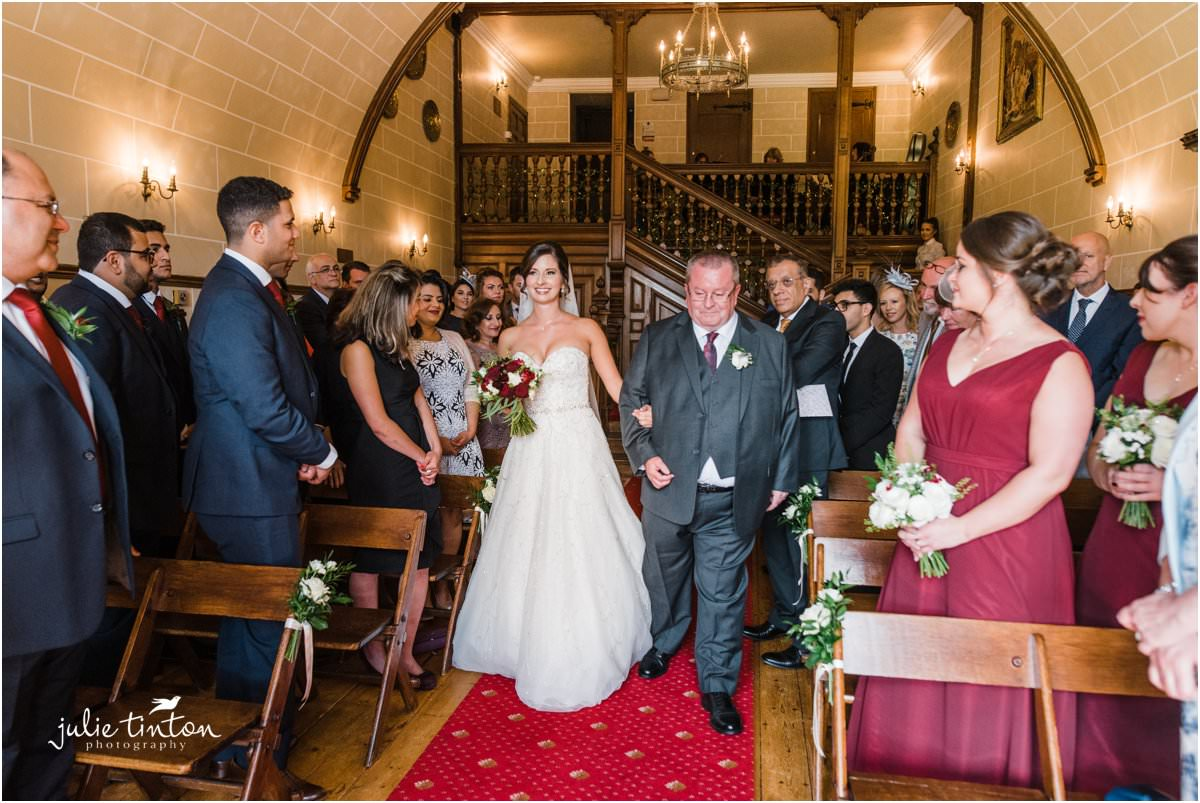 Bride and Father walking up aisle at Dalhousie Castle