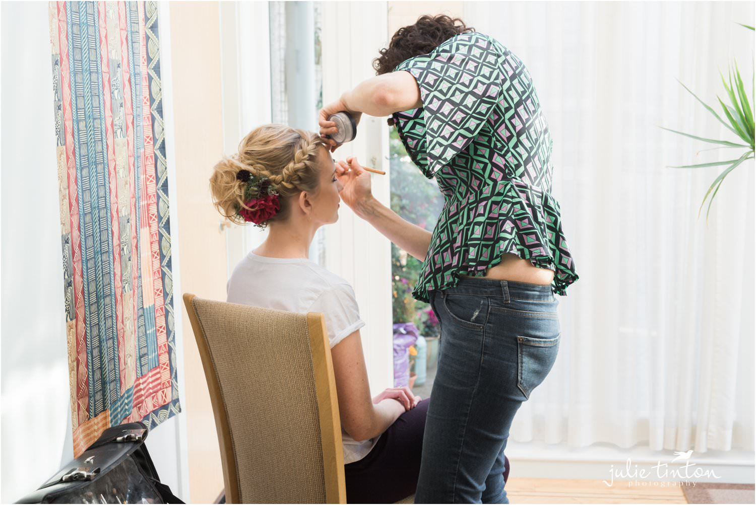 Make up artist with bride on morning of her wedding