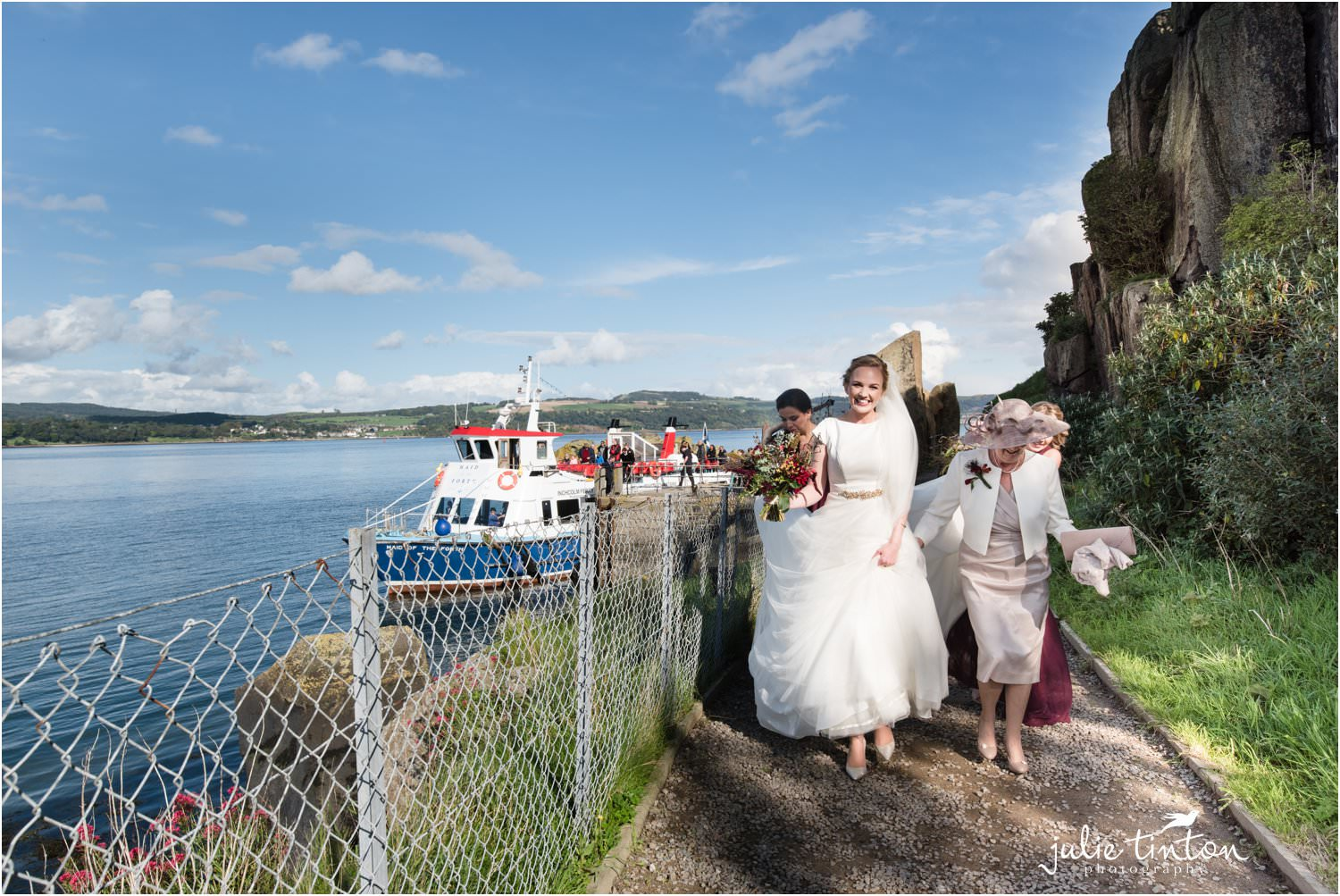 Happy Bride with bridal party walking to her ceremony on Inchcolm Island