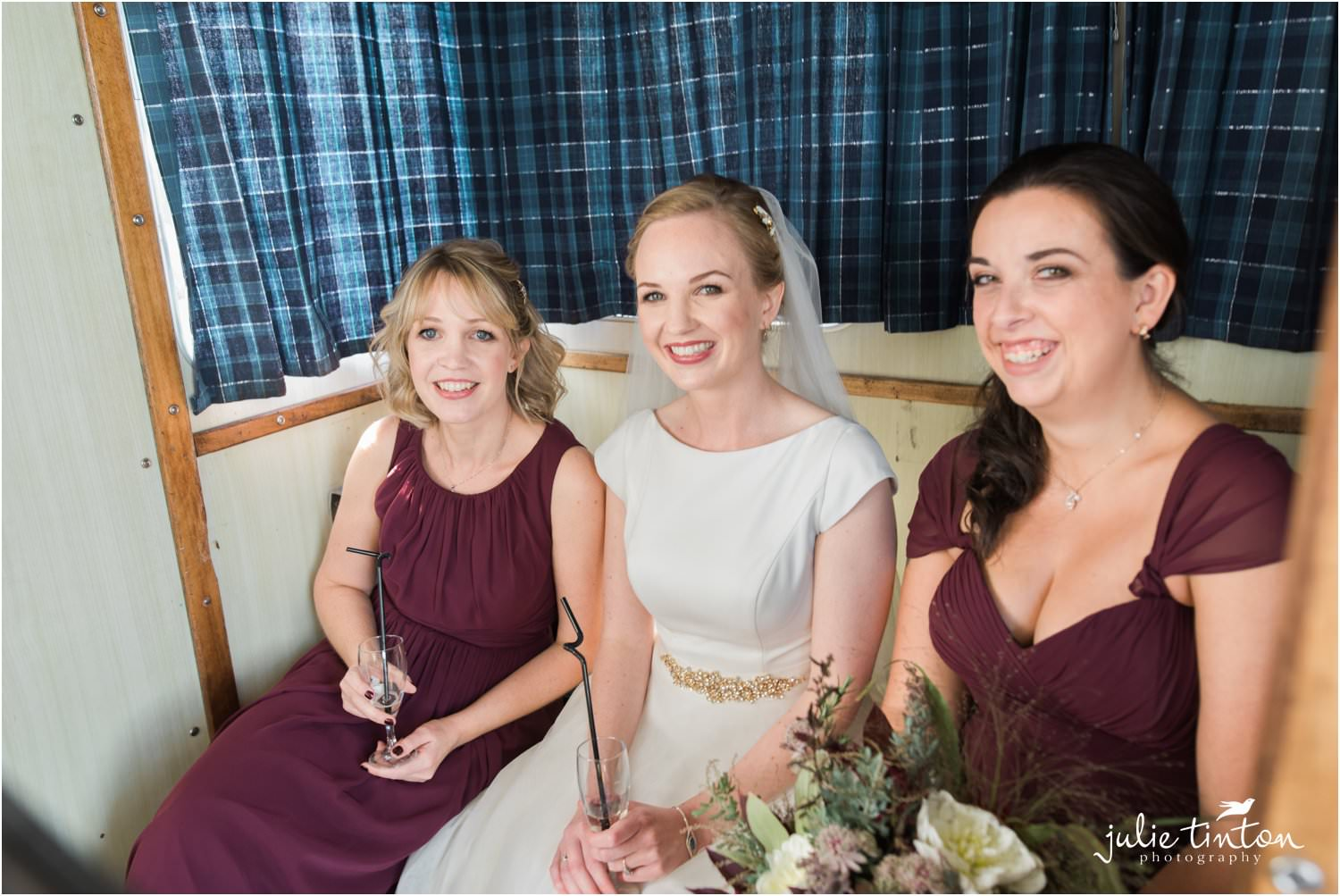 Bride and bridesmaids in Maid of Forth cabin crossing to Inchcolm Island
