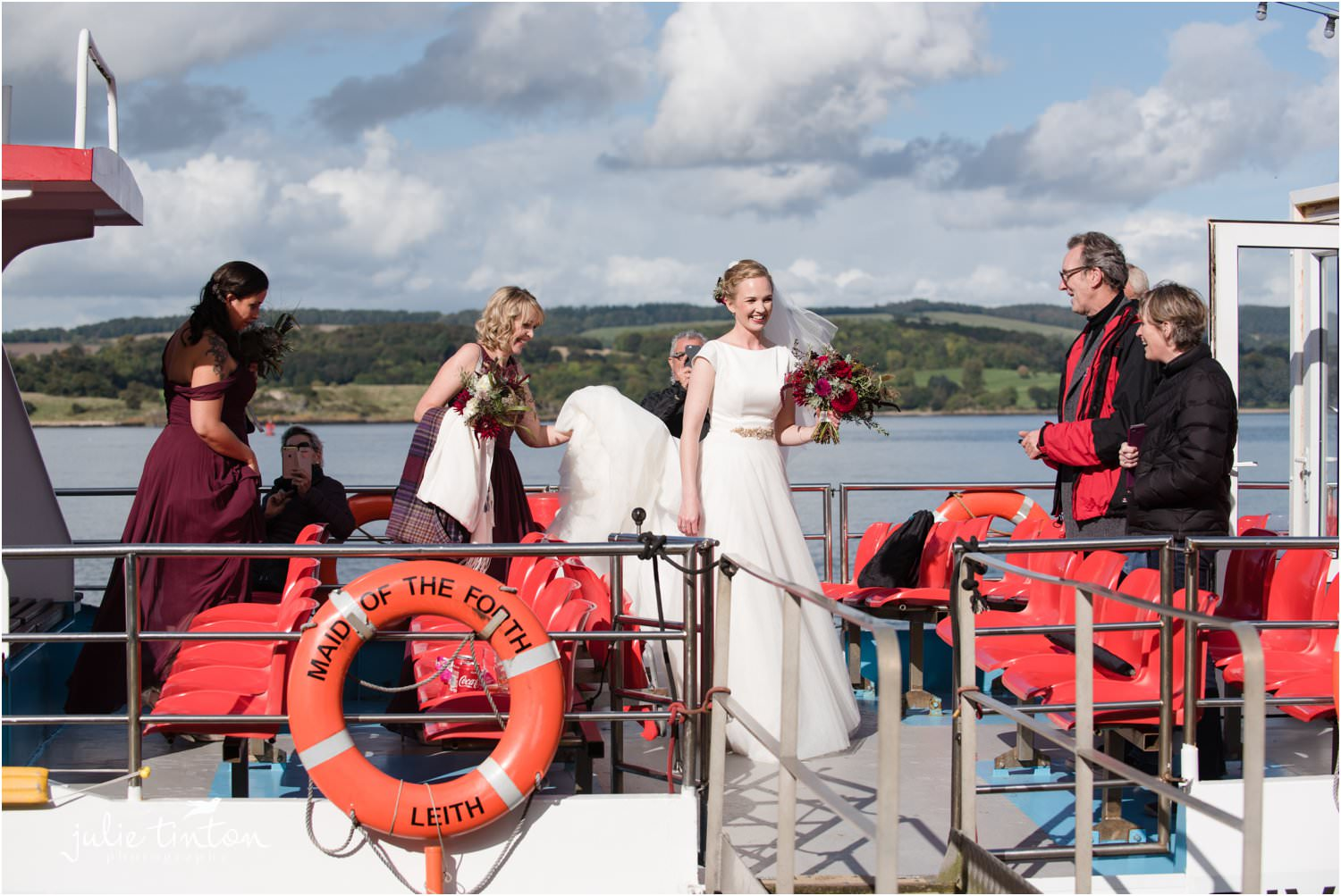 Bride arriving at Inchcolm Island on a sunny day for her wedding