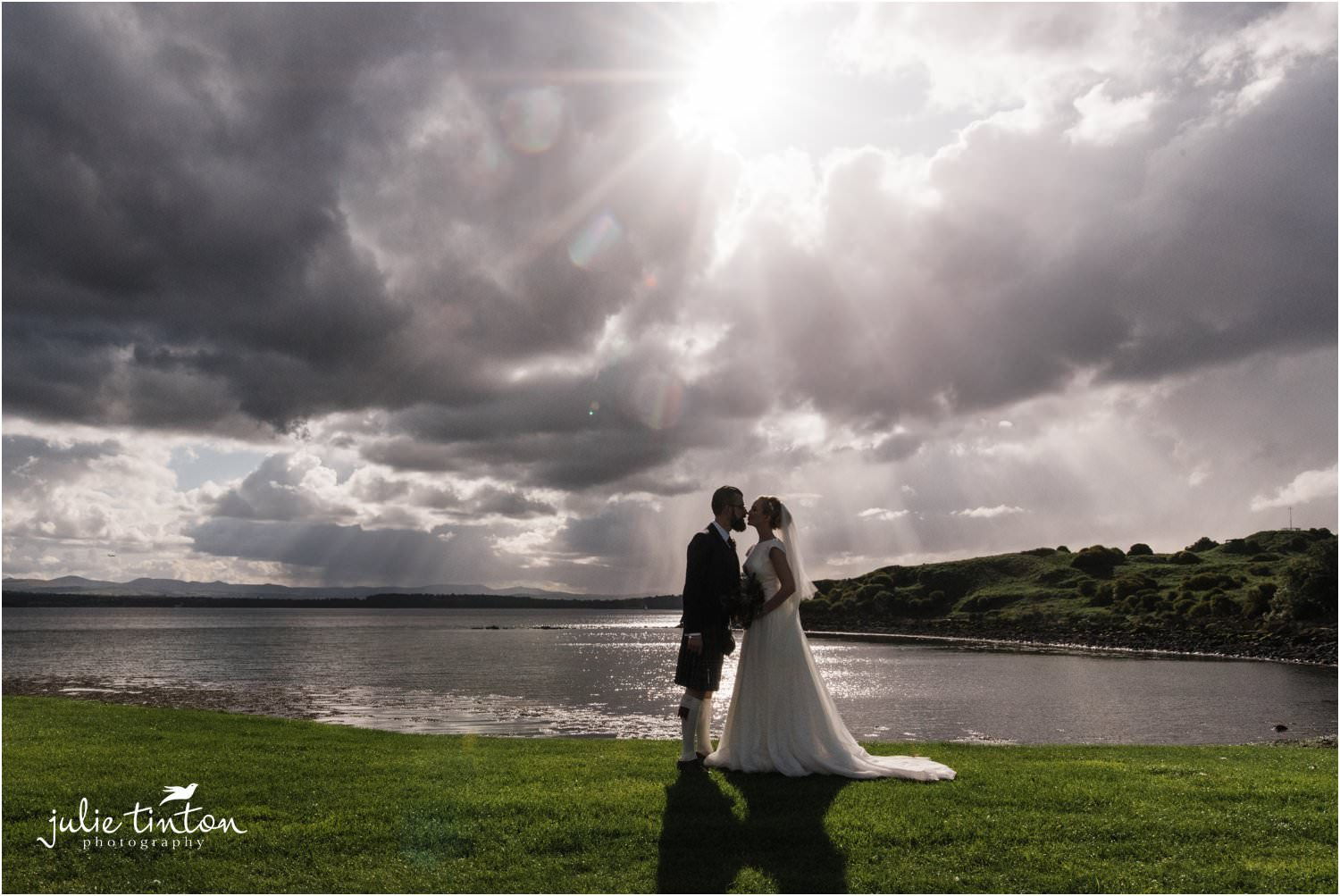 Silhouette of Bride and Groom kissing on Inchcolm Island Scotland