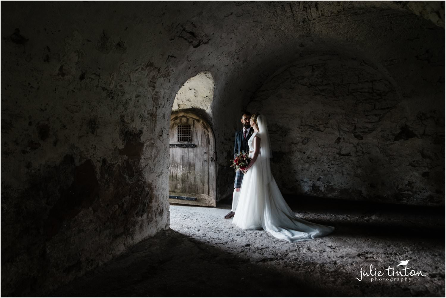 Inchcolm Island wedding couple standing in a doorway
