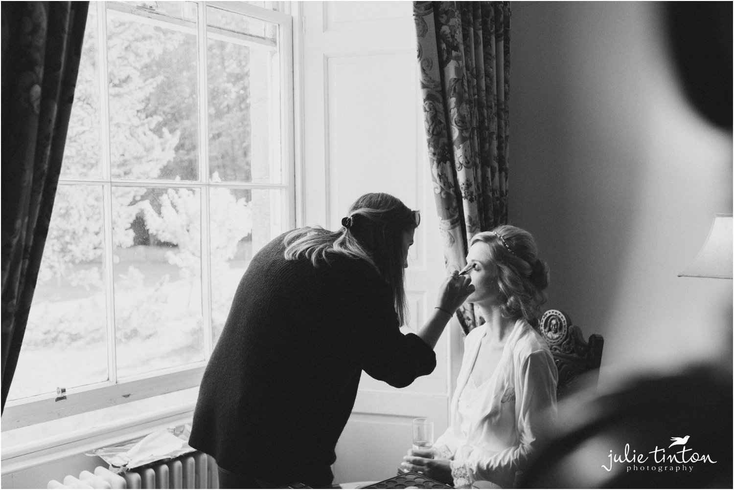 Bride at Broxmouth Park having her make up applied for her wedding