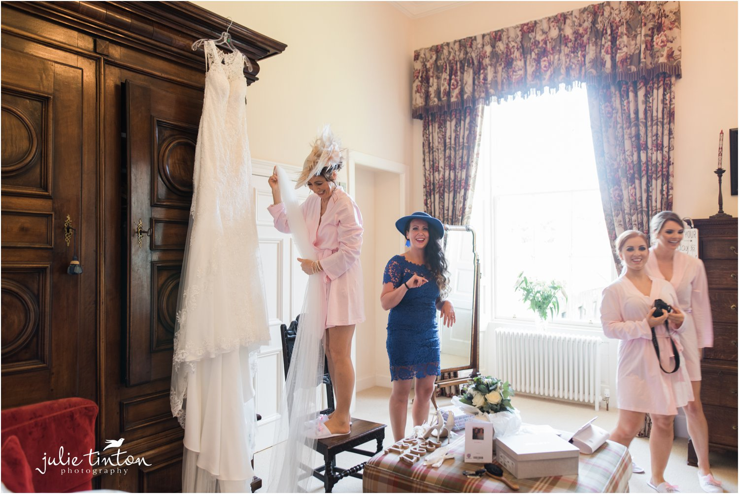 Fixing wedding dress at Broxmouth Park