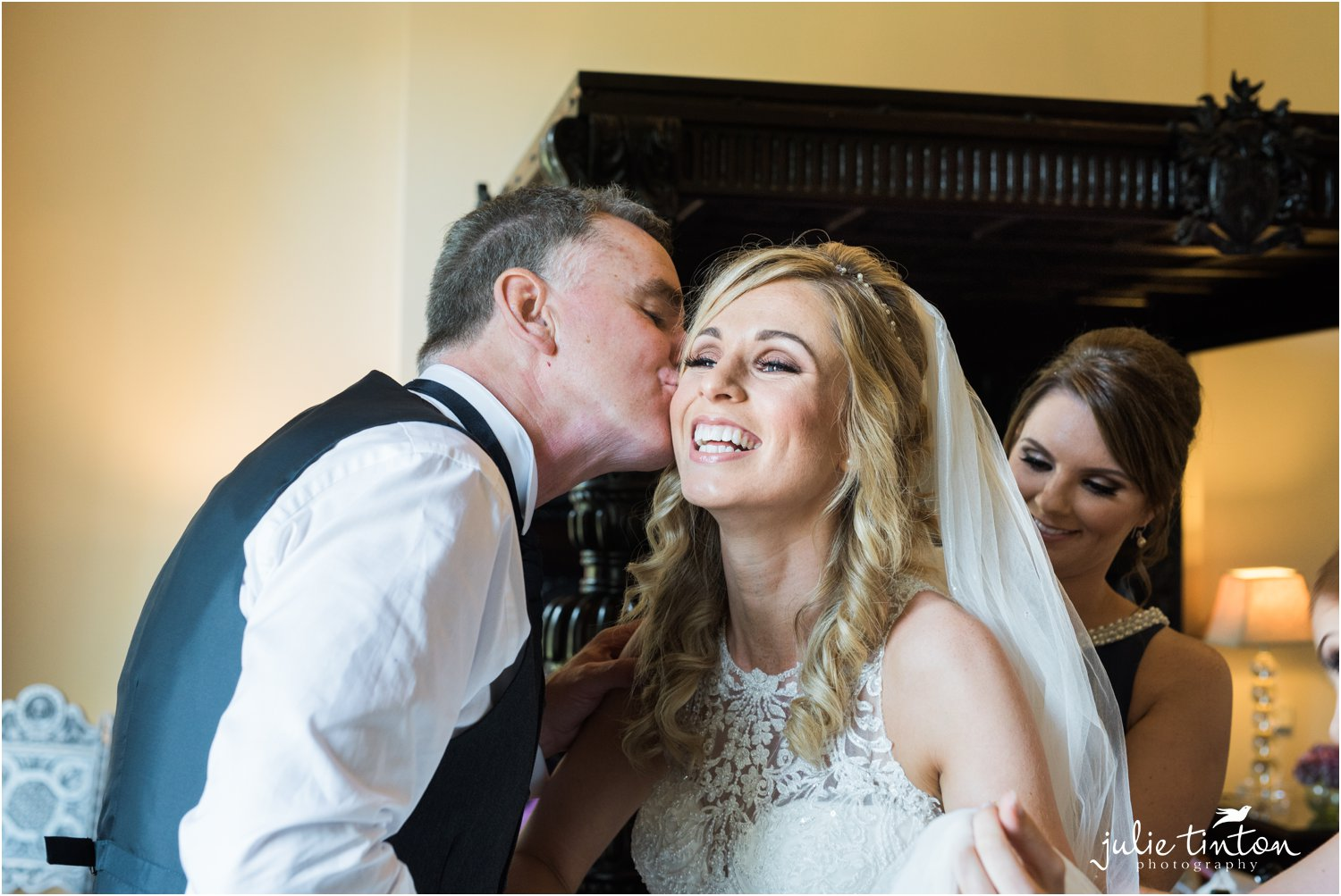 Bride being kissed by her Father at Broxmouth House
