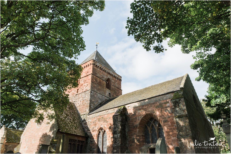 St Mary's Parish Church shot through trees, Whitekirk