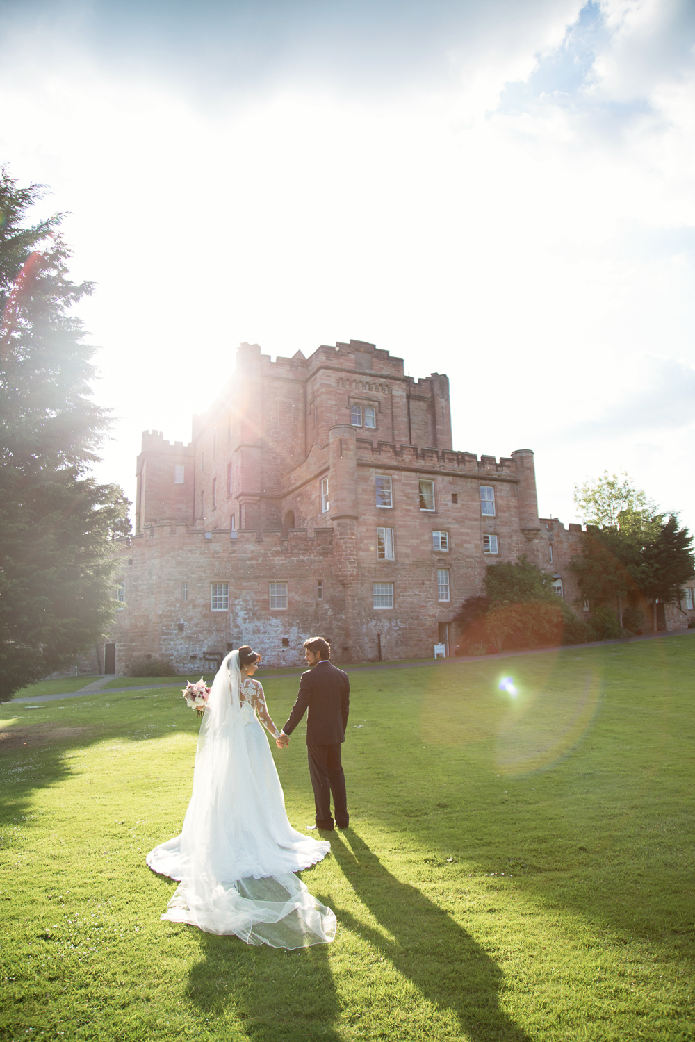 Romantic sunset of bride and groom at Dalhousie Castle