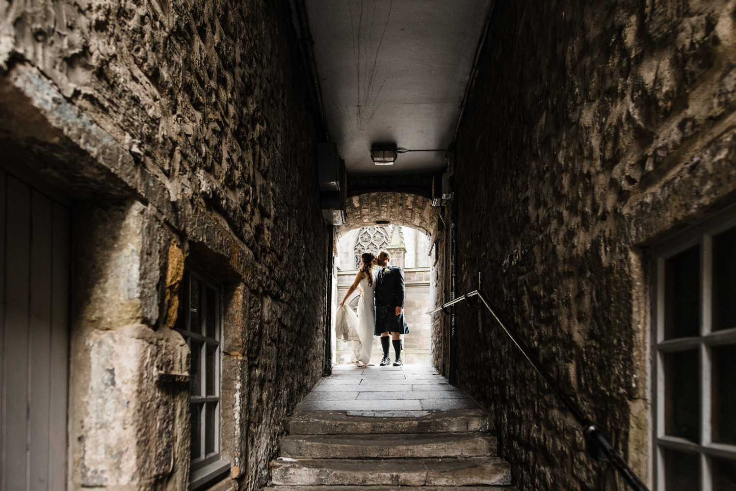 Bride and Groom kissing in Edinburgh Close