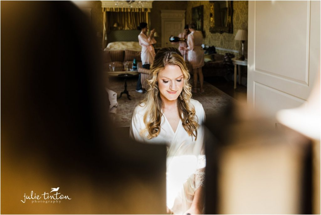Bride at mirror bridal prep