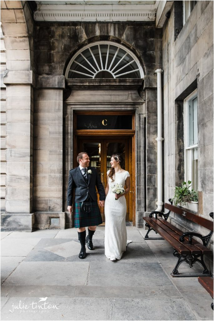 Bride and Groom walking at Edinburgh City Chambers