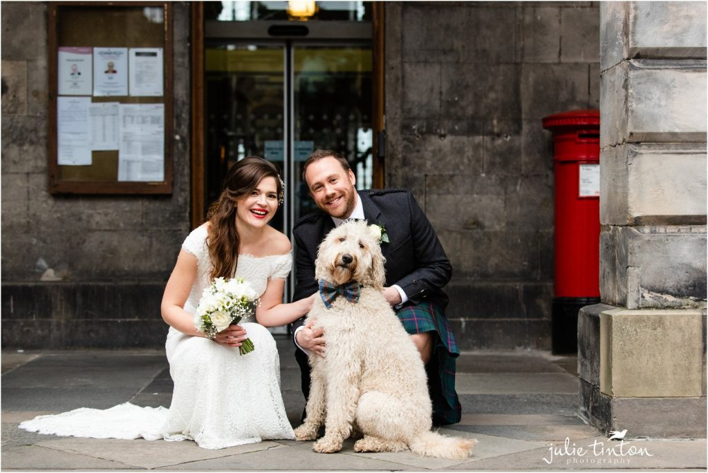 Bride and Groom with their dog on wedding day