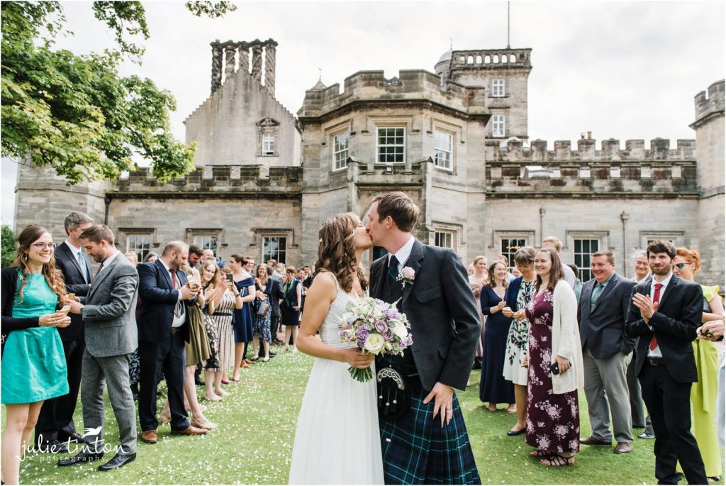 bride and groom kissing at Winton Castle