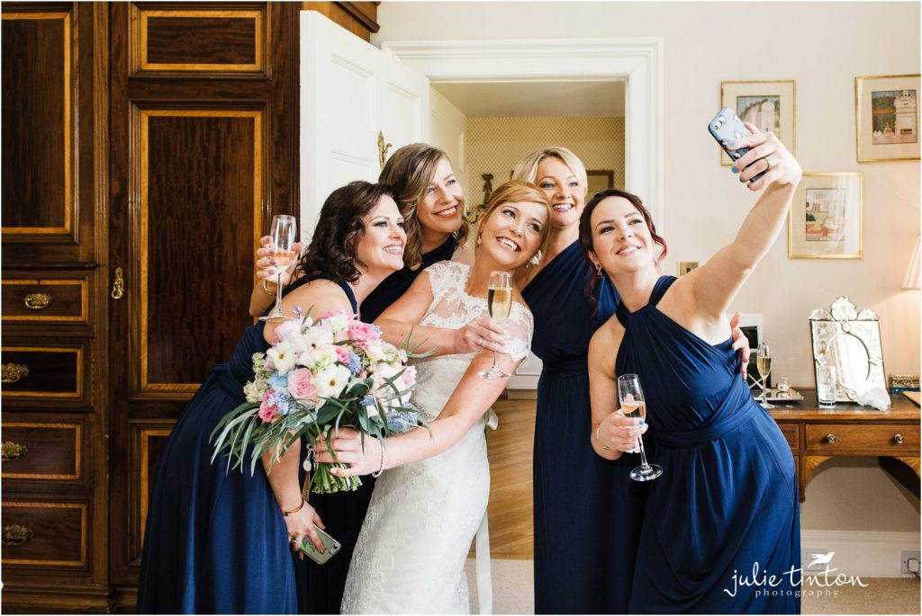 Bride and bridemaids taking a selfie