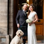 Bride and Groom with their dog at Edinburgh City Chambers